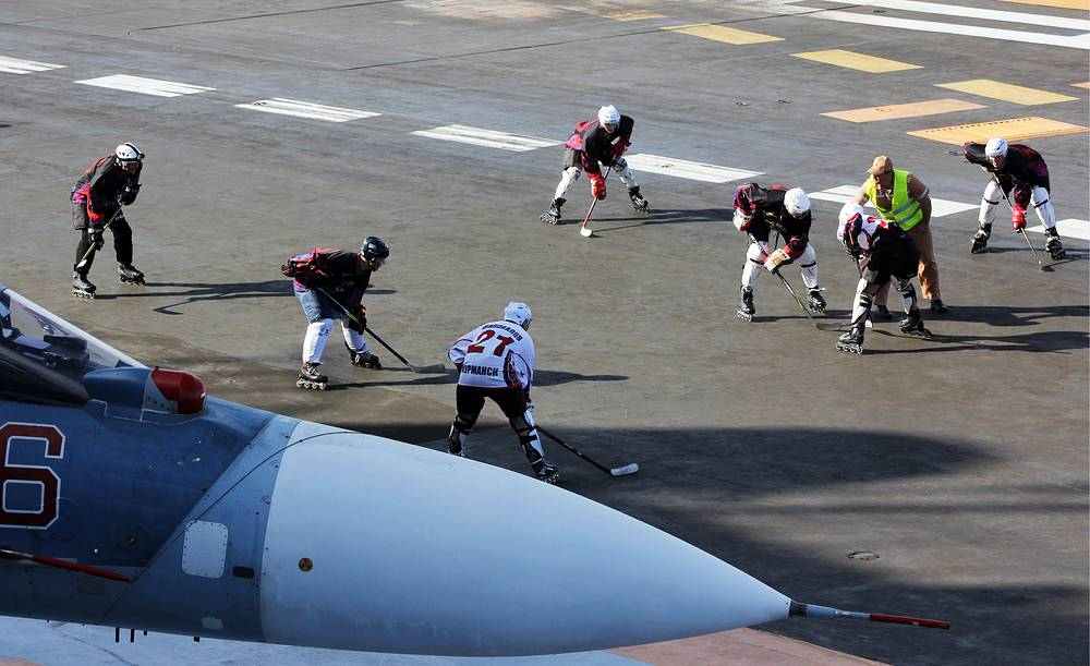 Russian servicemen playing hockey on the flight deck of Admiral Kuznetsov aircraft carrier