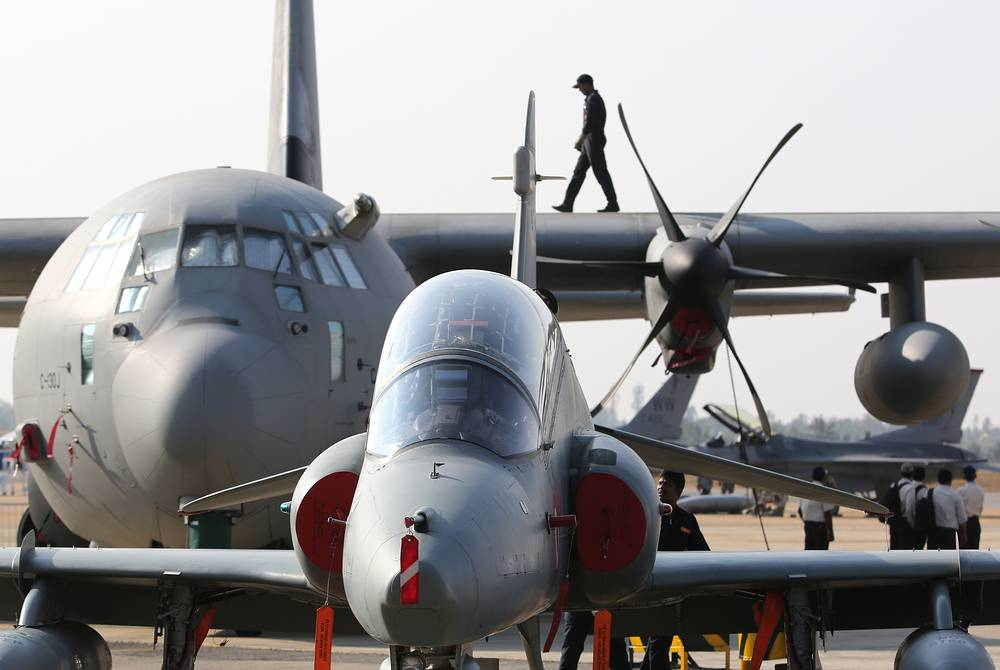 A HAL Tejas multirole light fighter aircraft developed by India's Hindustan Aeronautics Limited and a US Lockheed C-130 Hercules four-engine turboprop military transport aircraft