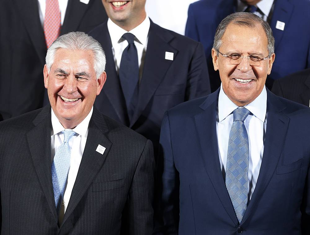 The Russian foreign minister Sergey Lavrov and US Secretary of State Rex Tillerson stand together during the G-20 Foreign Ministers meeting in Bonn, Germany, February 16