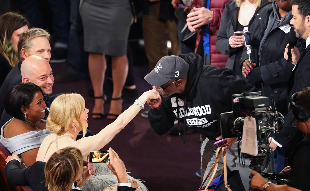A tourist kisses the hand of actor Nicole Kidman at the 89th Academy Awards,  Hollywood, US, February 26