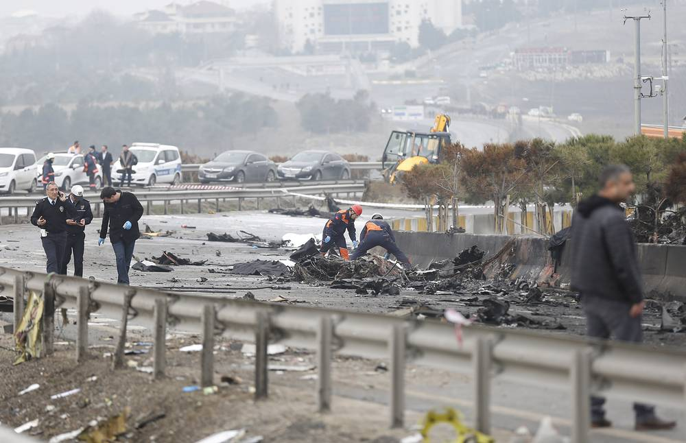 Firemen work at the accident site after a helicopter crashed in Beylikduzu district in Istanbul, Turkey