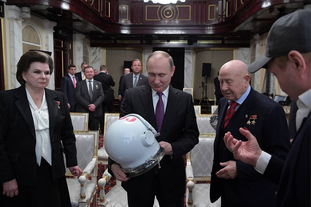 First woman in space, Russian State Duma member Valentina Tereshkova, Russia's President Vladimir Putin, first cosmonaut to perform a spacewalk Alexei Leonov and Russian actor Yevgeny Mironov seen ahead of a screening of the film The Spacewalker, April 11