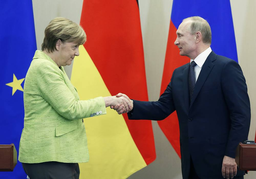 Russian President Vladimir Putin and German Chancellor Angela Merkel shakes hands after a press conference at the Bocharov Ruchei residence in the Black sea resort of Sochi, Russia, May 2