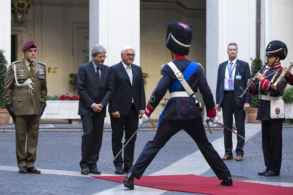 Italian Prime Minister Paolo Gentiloni accompanies German President Frank-Walter Steinmeier during the official welcome prior to their meeting at the Chigi Palace in Rome, Italy, May 3