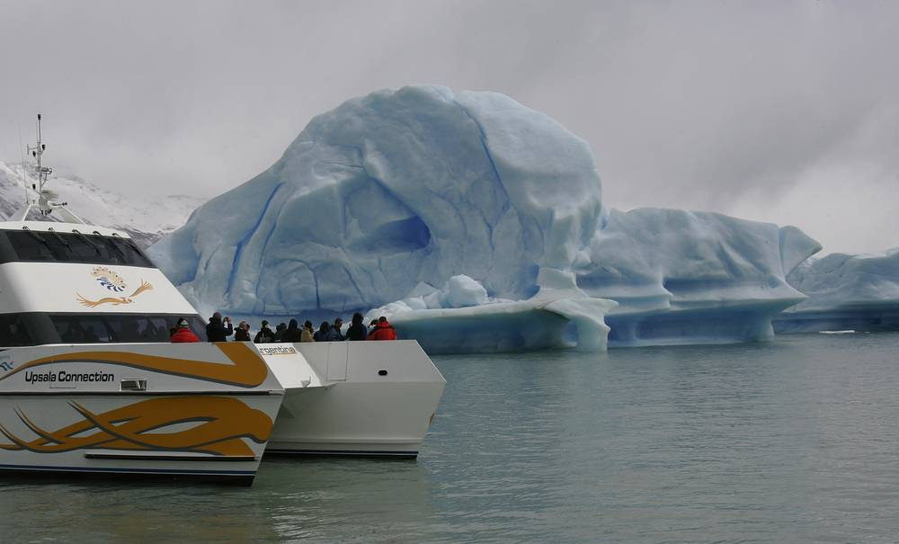 A ship transporting tourists approaches icebergs from Upsala Glacier in Lake Argentino