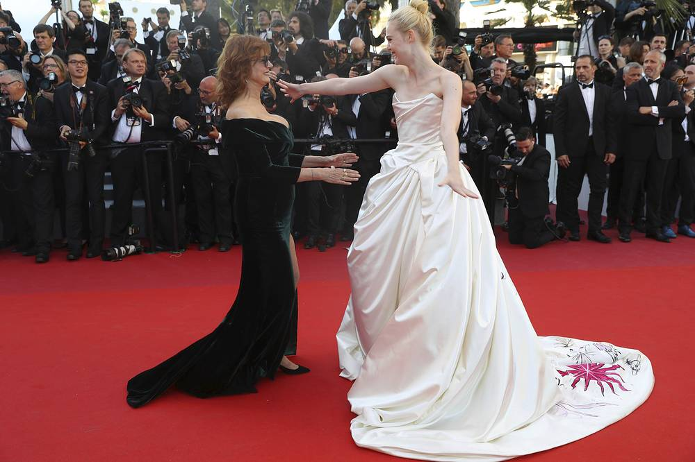 Actresses Susan Sarandon and Elle Fanning greet each other upon arrival at the opening ceremony and the screening of the film Ismael's Ghosts at the 70th international film festival, Cannes