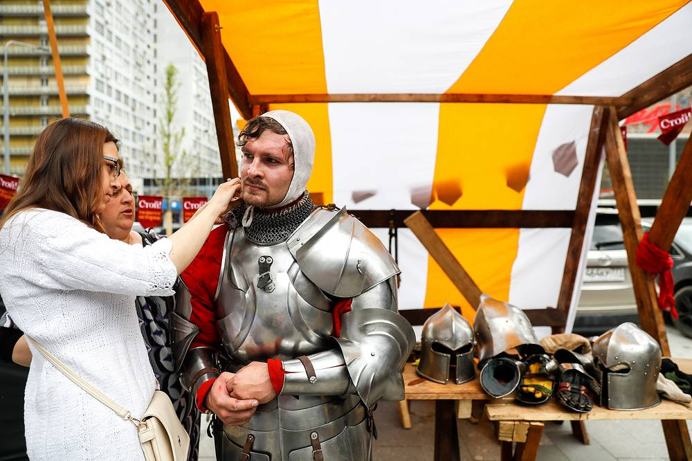 "Participants in the ""Shield and Sword"" historical fencing tournament in Novy Arbat Stree tas part of the festival"