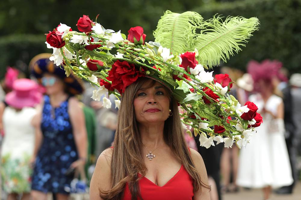A racegoer arrives on the opening day of Royal Ascot near London, Britain