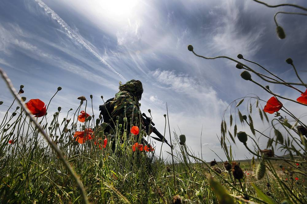 A sniper of a motor rifle of the Russian Armed Forces takes part in special tactical and firearms training at the Kadamovsky range, Russia, June 22