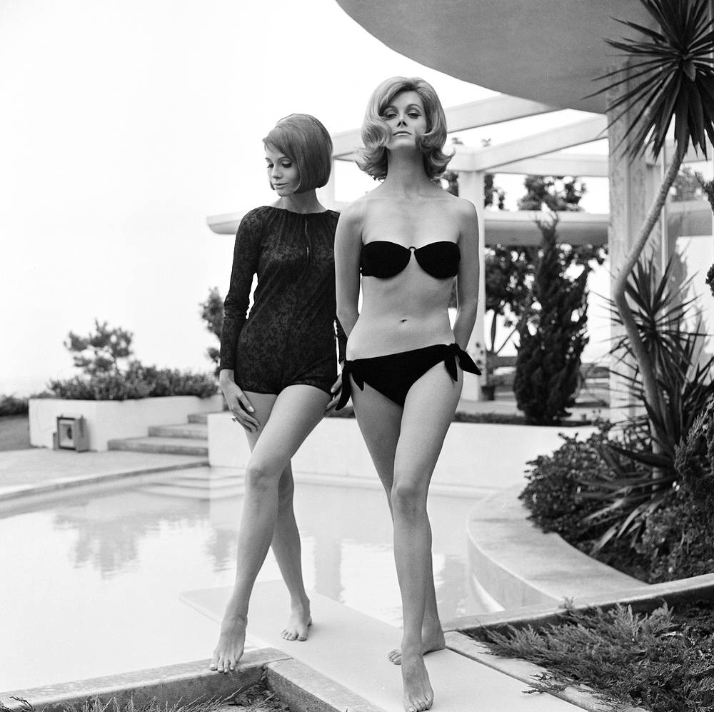 Therese Baldwin and Carol Merrill model California's new bathing suit styles, 1964