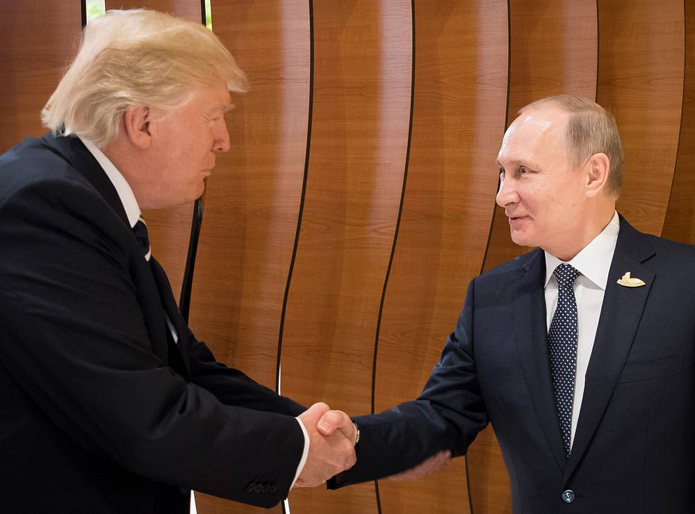 US President Donald Trump shaking hands with Russian President Vladimir Putin at the opening day of the G20 summit in Hamburg, Germany, July 7