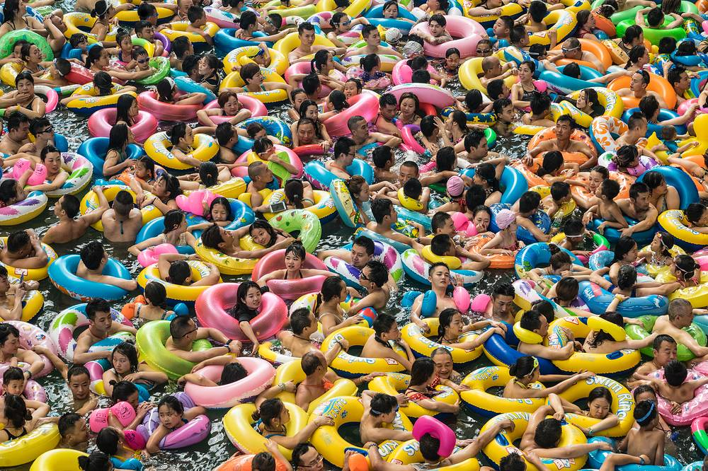 Chinese tourists with swim rings enjoy swimming in the lake called 'Dead sea of China' in a resort of Suining city, southwestern China's Sichuan province, July 22