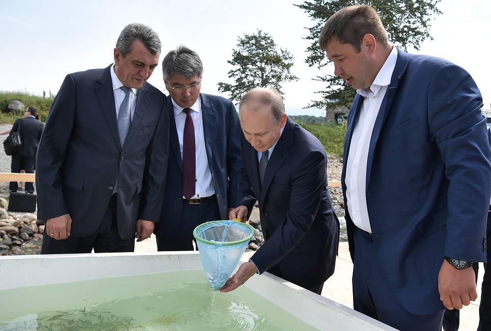 Russia's President Vladimir Putin takes part in a ceremony to release young omul fish into Lake Baikal at the Baikal State Nature Biosphere Reserve, Russia, August 4