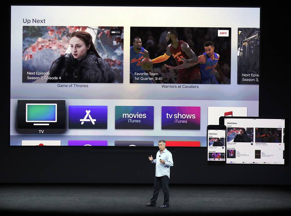 Eddy Cue, Apple's senior vice president of internet software, shows the new Apple TV product