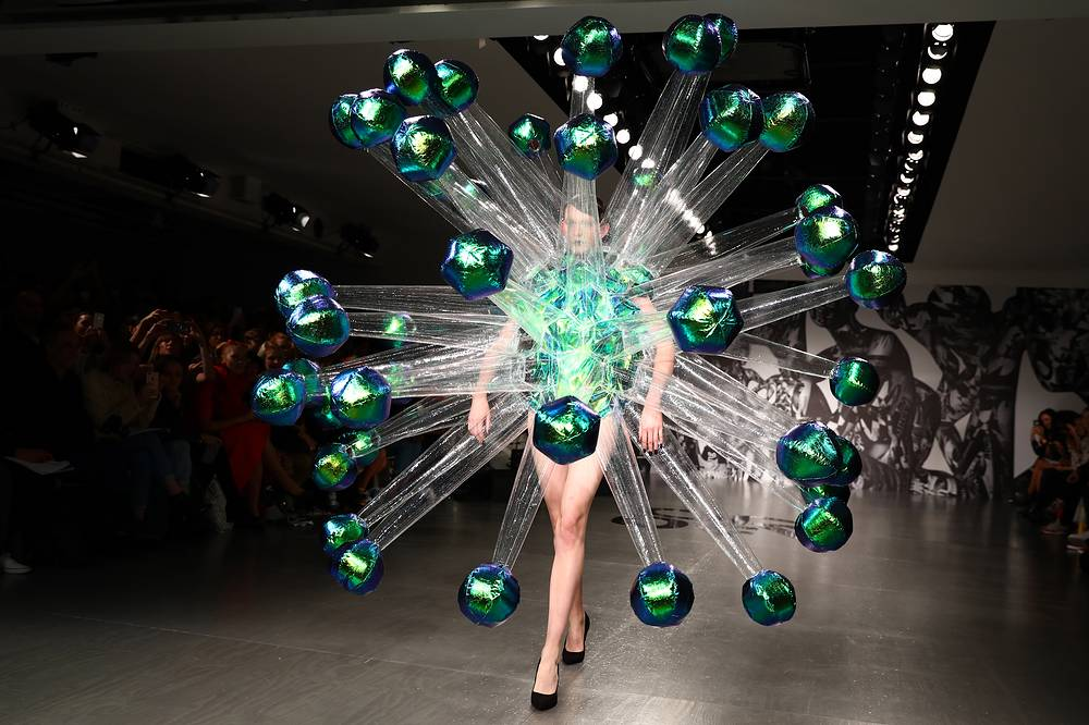 A model presents a creation by British label On/Off during the London Fashion Week, in London, Britain, September 19