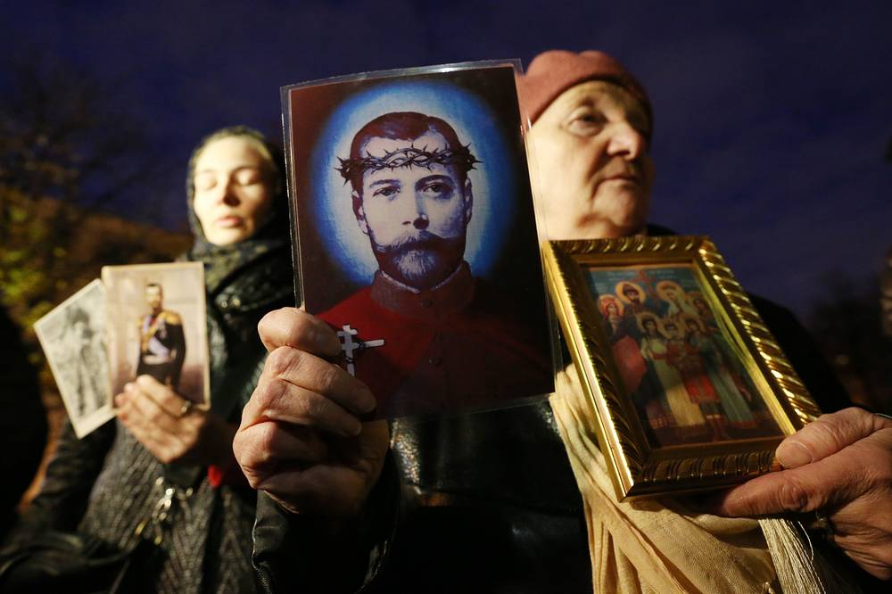 Orthodox believers hold photographs and drawings of Nicholas II of Russia in protest against Matilda, a film directed by Alexei Uchitel and premiered at the Mariinsky Theatre, Saint Petersburg, Russia, October 23