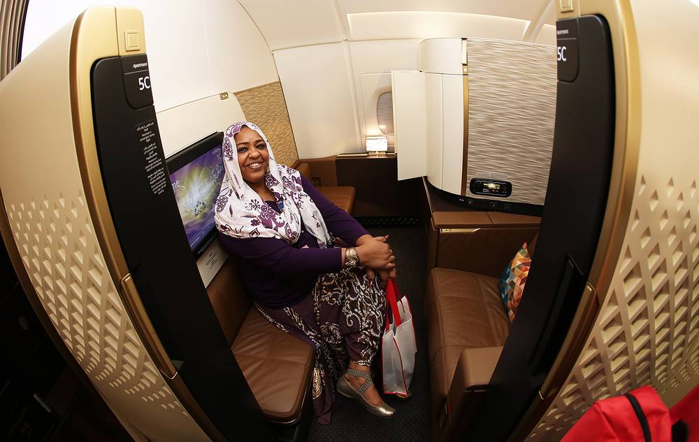 A visitor in the first class cabin of an Airbus A380-800 jet airliner operated by Etihad Airways