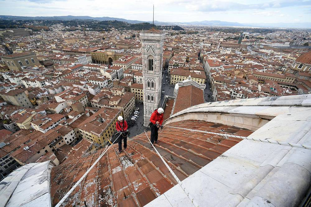 Experts working to control the marble surfaces of the Duomo and the bell tower of Giotto in Florence, Italy, November 14