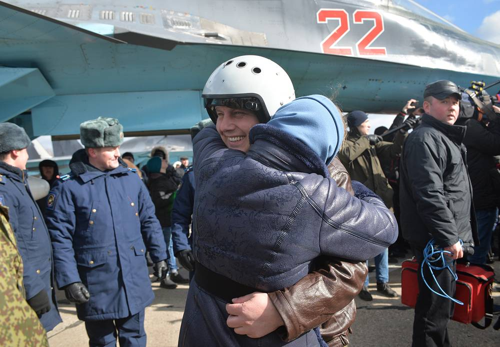 A Russian Aerospace Force pilot reunites with his family during the arrival ceremony in Voronezh Region as the first group of Russian Sukhoi Su-34 fighter bombers returned from Syria, March 15, 2016