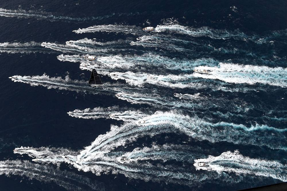 Black Jack leads the fleet down the coast following the start of the Sydney to Hobart Yacht race in Sydney, Australia, December 26