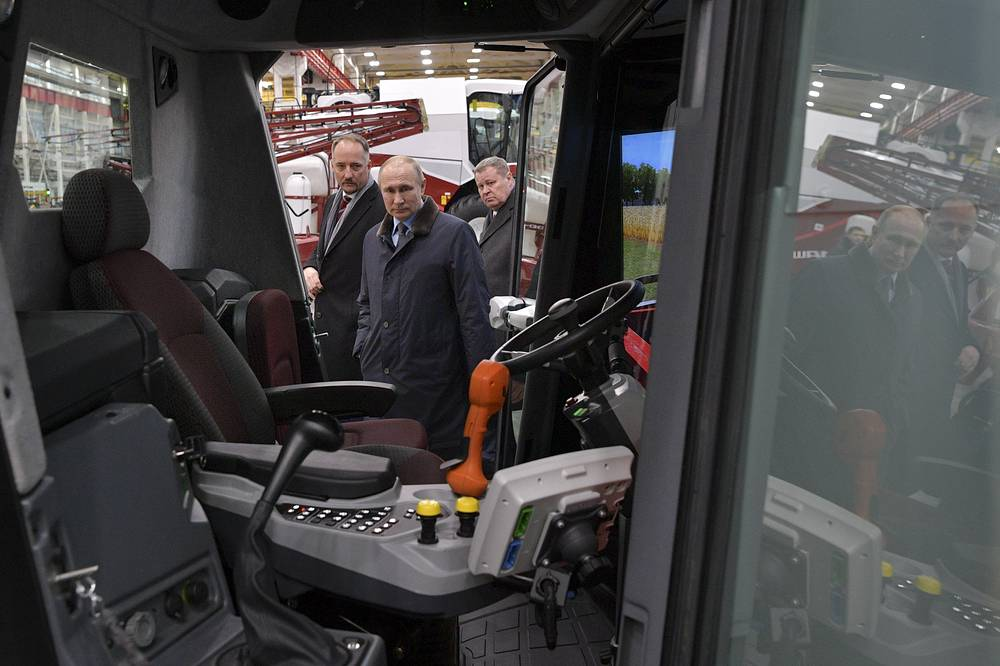 Russian President Vladimir Putin examines the cockpit of a combine machine as he visits Rostselmash, a Russian agricultural equipment company in Rostov-on-Don, Russia, February 1