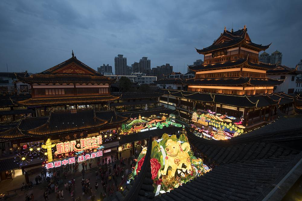A giant illuminated dog for the upcoming Year of the Dog is displayed as part of Lunar New Year festivities at Chenghuang Temple in Shanghai, China
