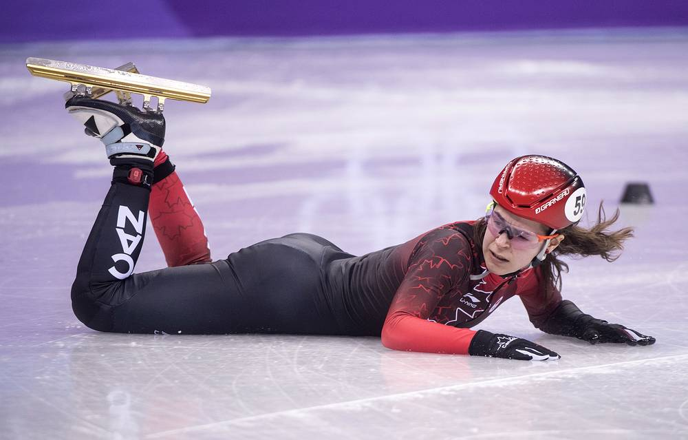 Canada's Jamie MacDonald falls during women's 500 metre heats