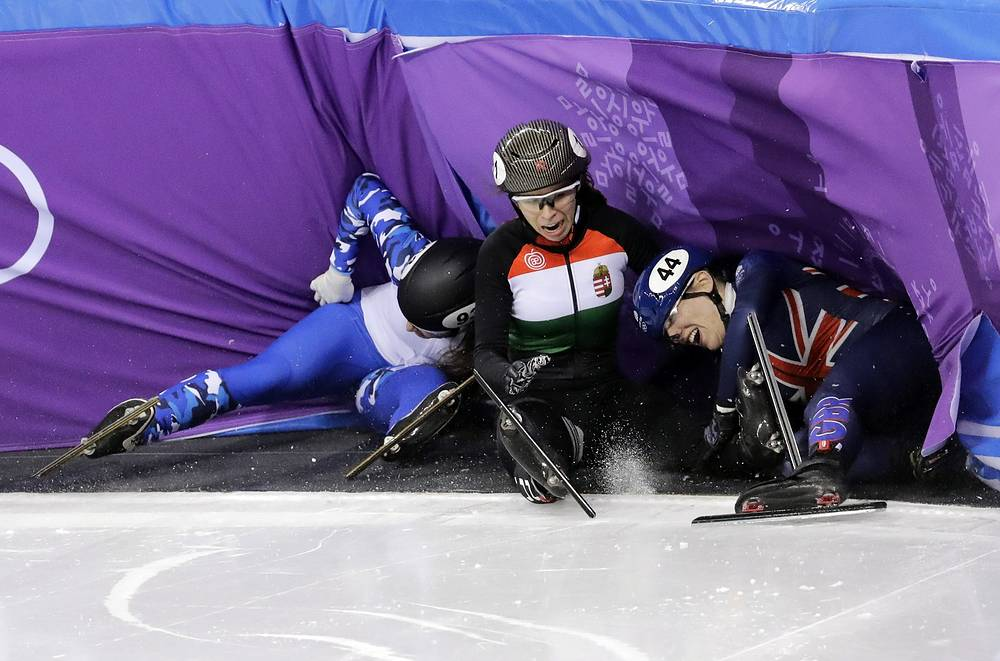 Charlotte Gilmartin of Britain, Petra Jaszapati of Hungary and Emina Malagich of the Olympic Athletes of Russia crash in women's 500 meters short-track speedskating