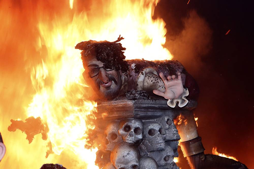 """Every year the city of Valencia celebrates the ancient """"Las Fallas"""" fiesta, a noisy week that is full of fireworks and processions, burning many characters and large papier mache satirical figures displayed around the streets of the city"""