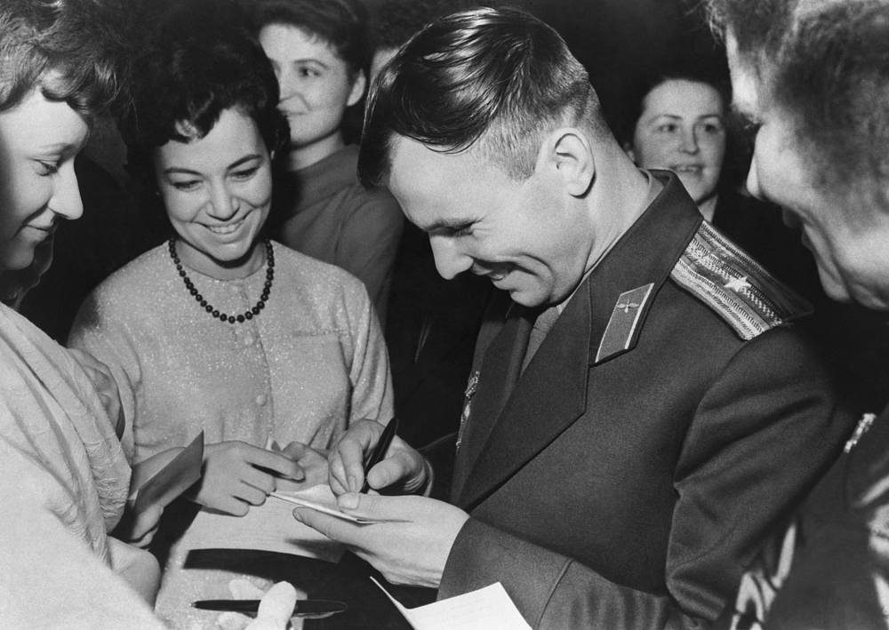 First cosmonaut Yuri Gagarin signing autographs in the Grand Kremlin Palace, 1961