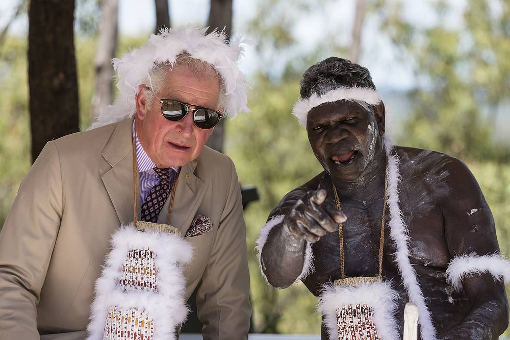 Prince Charles, the Prince of Wales, donning a traditional feather headband and string basket necklace, speaks with an Aboriginal indigenous elder during a Welcome to Country Ceremony at Mt.Nhulun in Gove, Arnhem Land, Australia, April 9