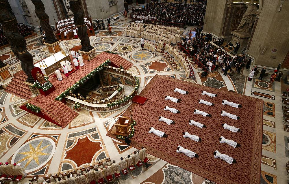 New priests lie face down on the floor during an ordination ceremony presided over by Pope Francis, in St. Peter's Basilica at the Vatican, April 22. Pope Francis is reminding priests to always be merciful, as he ordained 16 men in a ceremony in St. Peter's Basilica