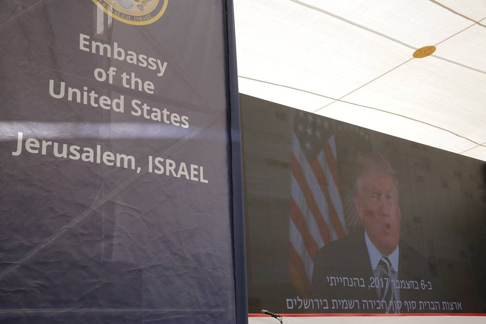 US President Donald Trump is seen on screen as he delivers his speech during the opening ceremony of the new US embassy in Jerusalem