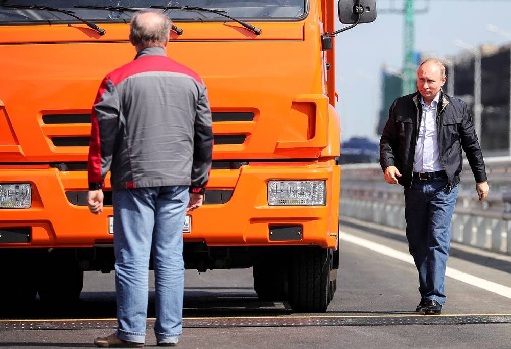 Russia's President Vladimir Putin seen by the lead vehicle, a Kamaz truck, ahead of a passage of construction machines through the Kerch Strait Bridge