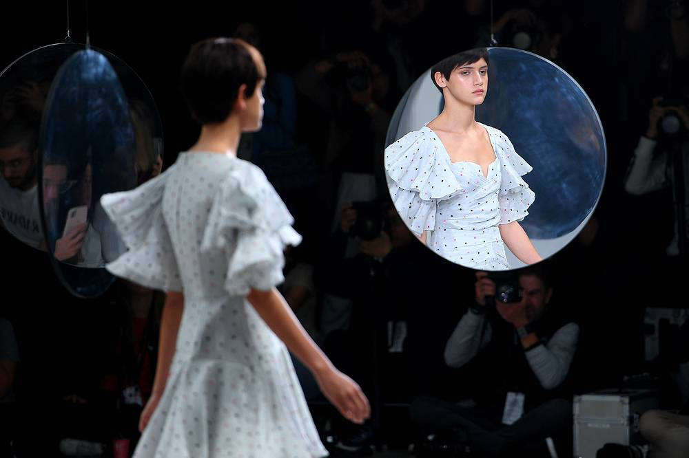 A model walks the runway wearing creations by Acler during the Mercedes-Benz Fashion Week Australia in Sydney, May 16