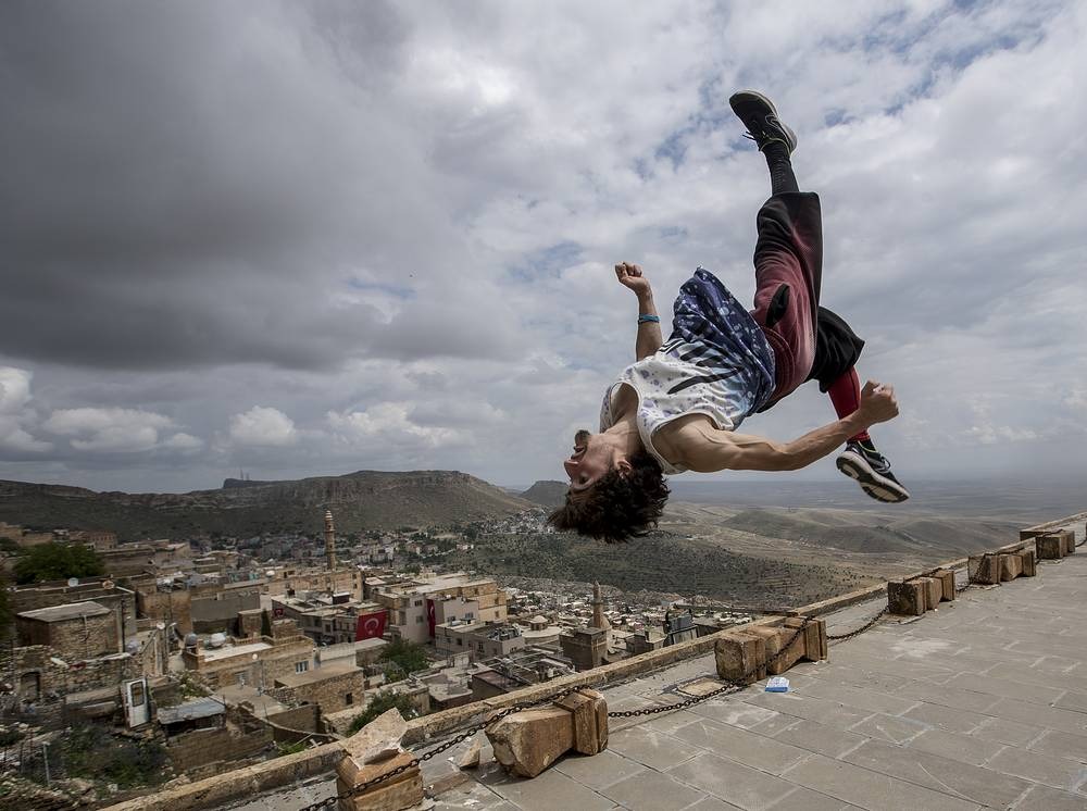 A participant in action during the Freerunning and Parkour World Series in old city of Mardin, Turkey, May 13