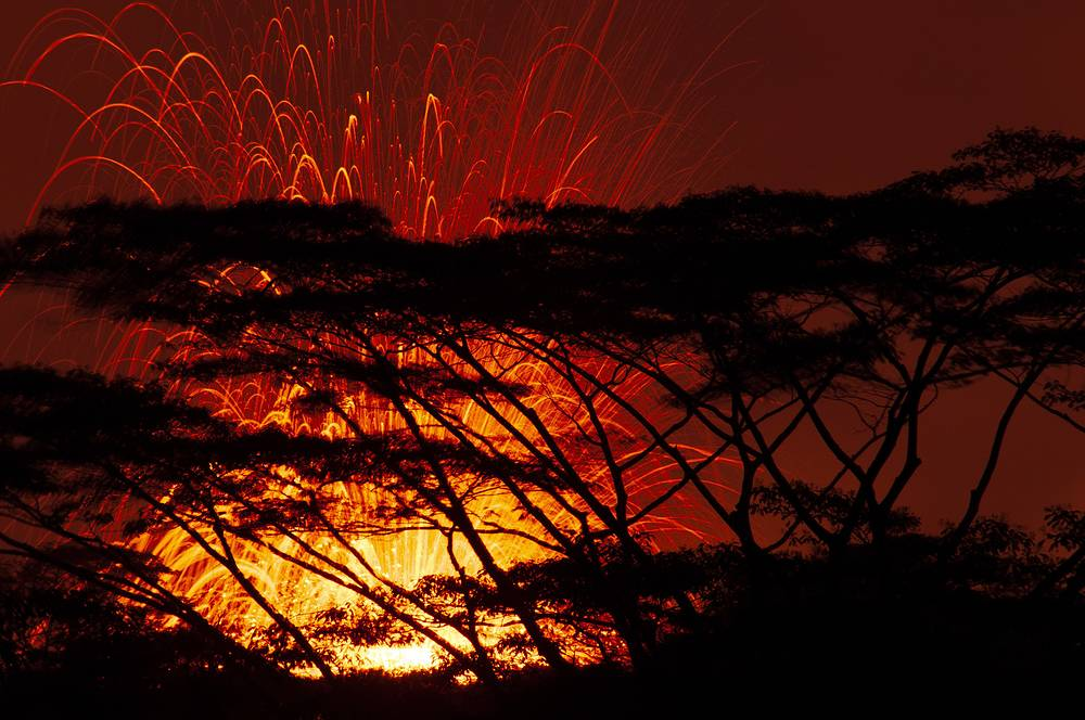 Lava fissure erupting in the air during a volcano outbreak at Pahoa, Hawaii