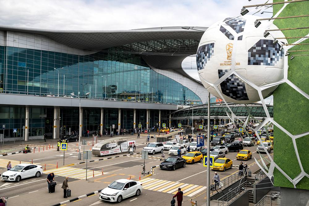 A three dimensional billboard with a ball in the net promoting the forthcoming FIFA World Cup Russia 2018 at the Sheremetyevo International Airport