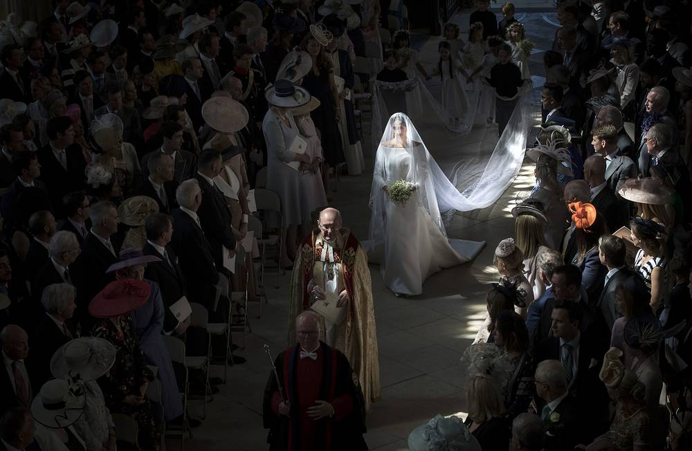 Meghan Markle and her bridal party walk down the aisle of St George's Chapel at Windsor Castle to tie the royal knot with Prince Harry in Windsor, May 19
