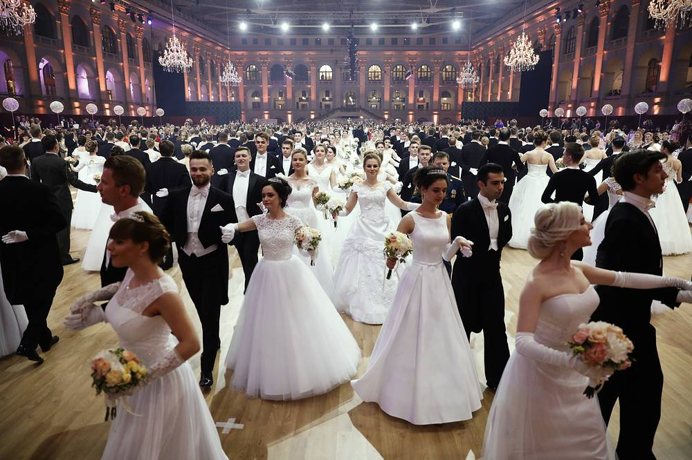 Young men and girls dancing during the 16th Viennese Ball charity event held at Moscow's Gostiny Dvor, May 26