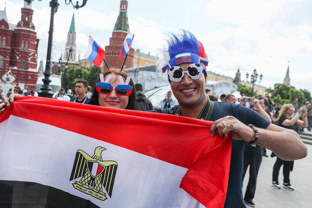 Fans pose with an Egyptian flag in Manezhnaya Square
