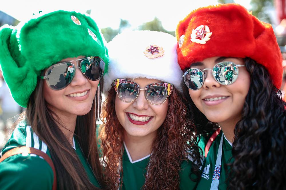 Mexican fans wearing ushanka hats in the colours of the Mexican national flag seen at Luzhniki Stadium in Moscow