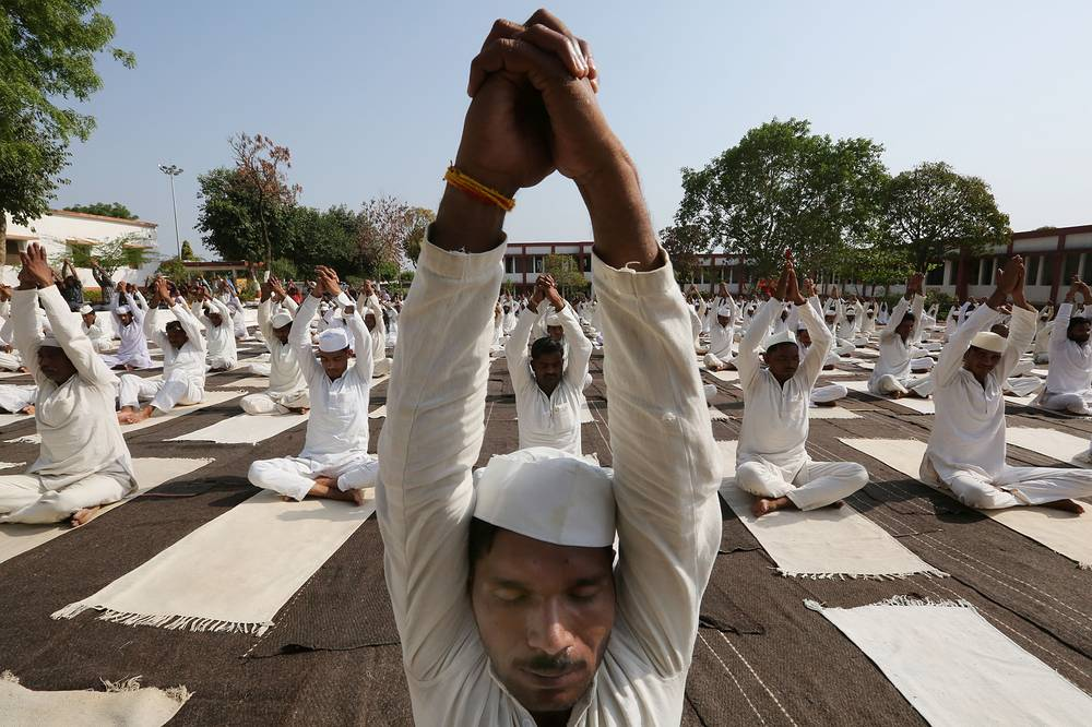 Inmates of Central Jail take part in a mass yoga session in Bhopal, India