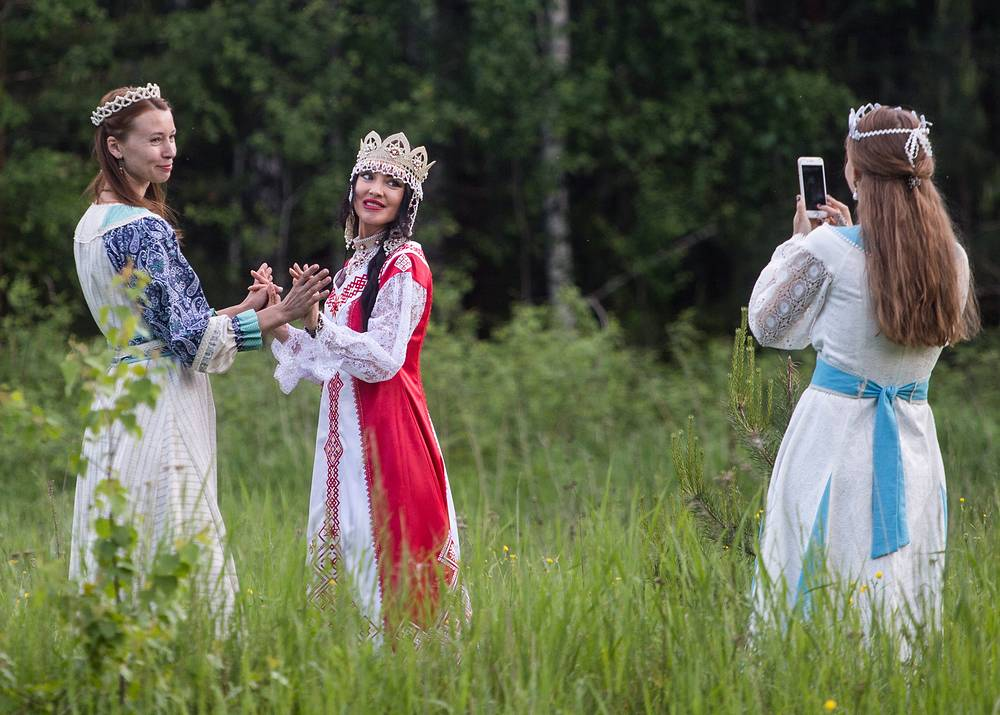 Girls in traditional Russian clothes in a field during a summer solstice celebration