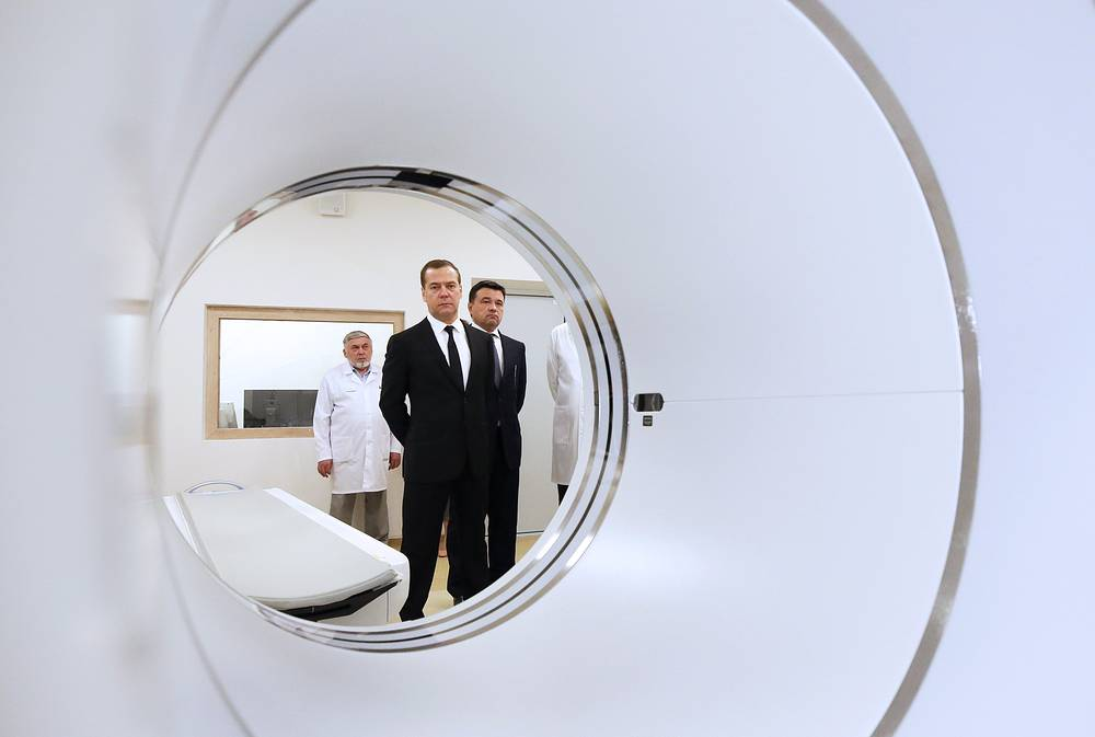 Russia's Prime Minister Dmitry Medvedev and Moscow Region Governor Andrei Vorobyov visit an oncoradiological cancer centre in the city of Balashikha, July 25