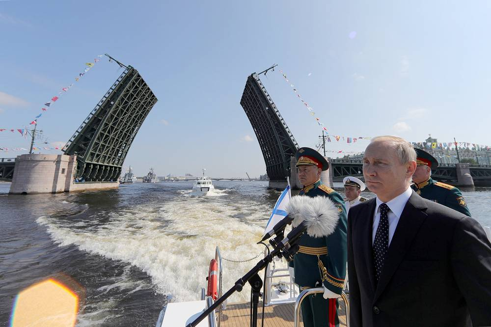 Russia's Defense Minister Sergei Shoigu and Russia's President Vladimir Putin watching the main naval parade in Saint Petersburg