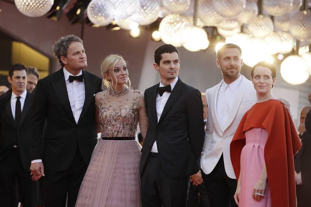 Actors Jason Clarke, Olivia Hamilton, director Damien Chazelle, actors Ryan Gosling and Claire Foy seen at the premiere of the film 'First Man'