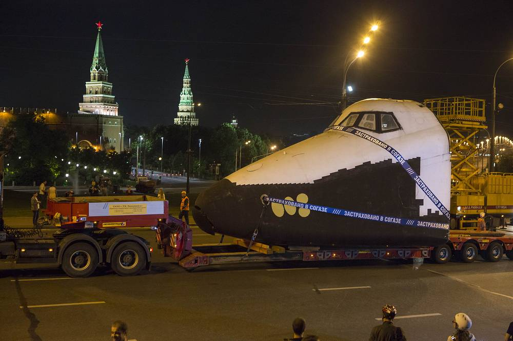 A front part of the model of Buran space shuttle being transported along the Kremlin in Moscow, 2014. The space shuttle Buran, displayed in Gorky Park, was moved to VDNKh Exhibition Centre