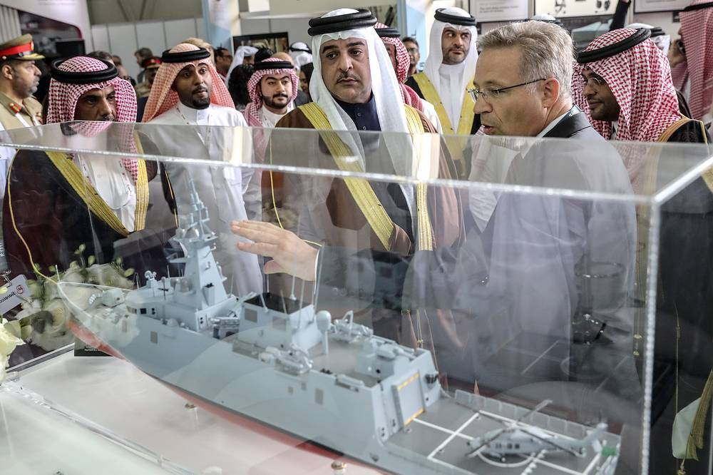 Prince Abdullah bin Hamad bin Isa Al Khalifa of Bahrain, Chairman of the BIAS High Organising Committee, views a warship scale model on display at the 2018 Bahrain International Air Show