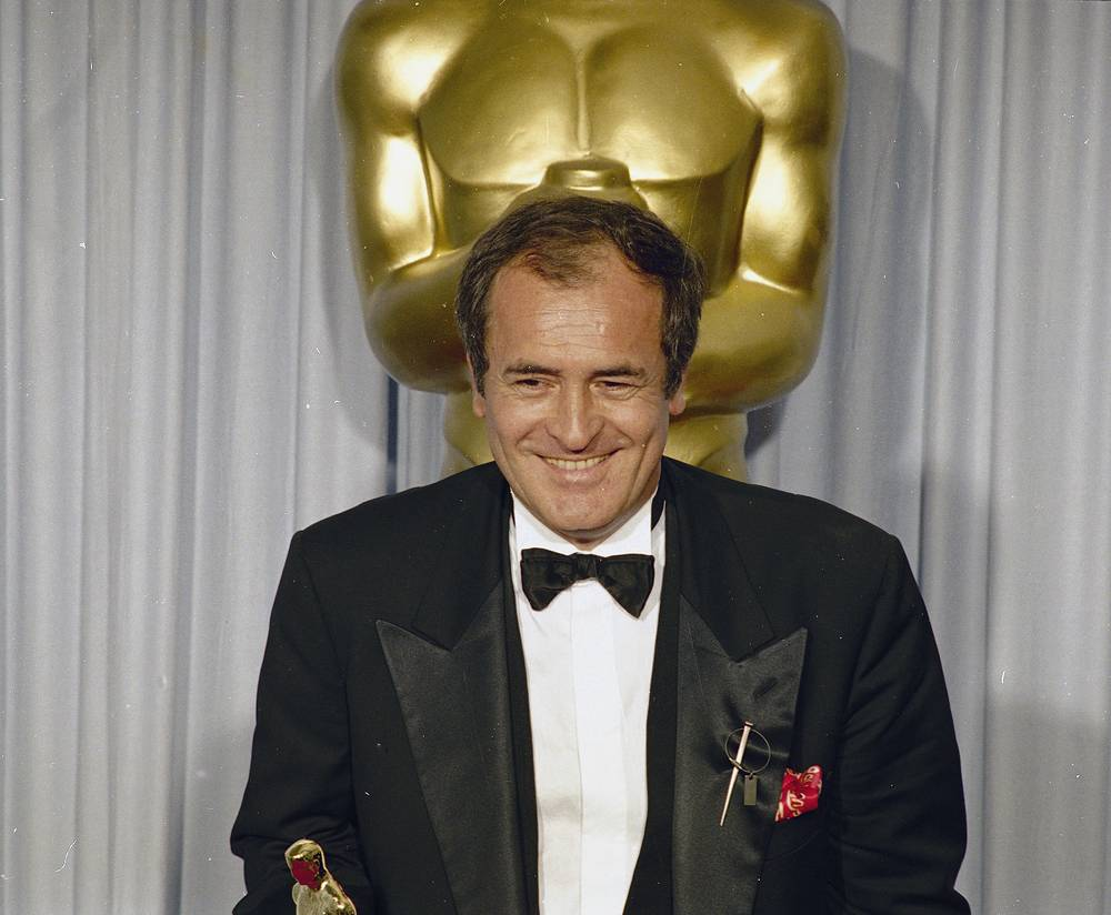 Bernardo Bertolucci holding his Best Director Oscar for 'The Last Emperor' at the Academy Awards in Los Angeles, 1988